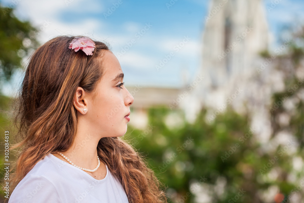 Fototapety, obrazy: Beautiful young girl at the River Boulevard  in front of the famous gothic church of La Ermita built on 1602 in the city of Cali in Colombia