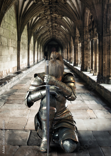 Female warrior knight kneeling proudly wearing decorative metal armor and holding a sword Fototapet