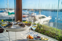 Dish With Oysters On A Table In A Restaurant With Sea View