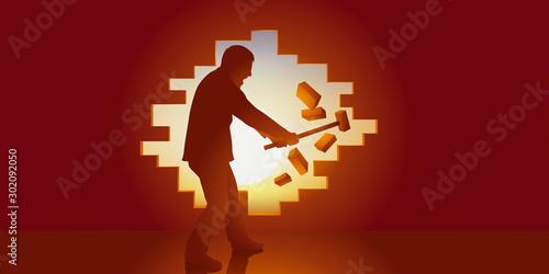 Fototapeta Concept de la liberté, avec un homme qui ouvre une brèche dans un mur pour s'échapper de sa prison et passer de l'ombre à la lumière