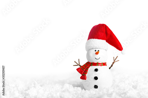 Photo  Toy of snowman on snow over white background