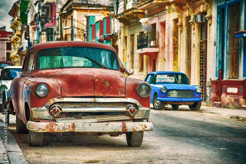 Photo Havana street in Cuba with old red american car