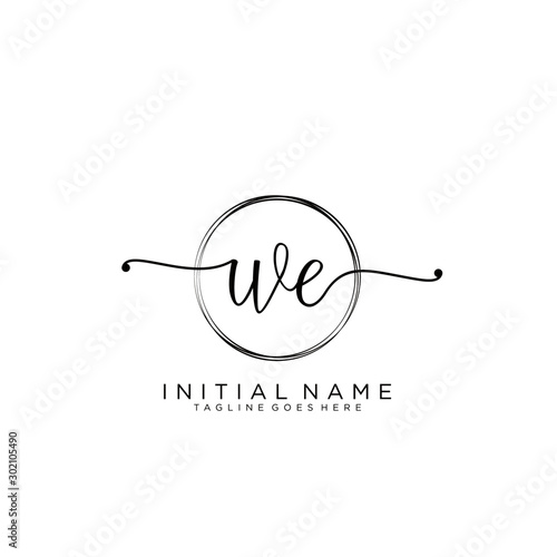 WE Initial handwriting logo with circle template vector. Fototapete