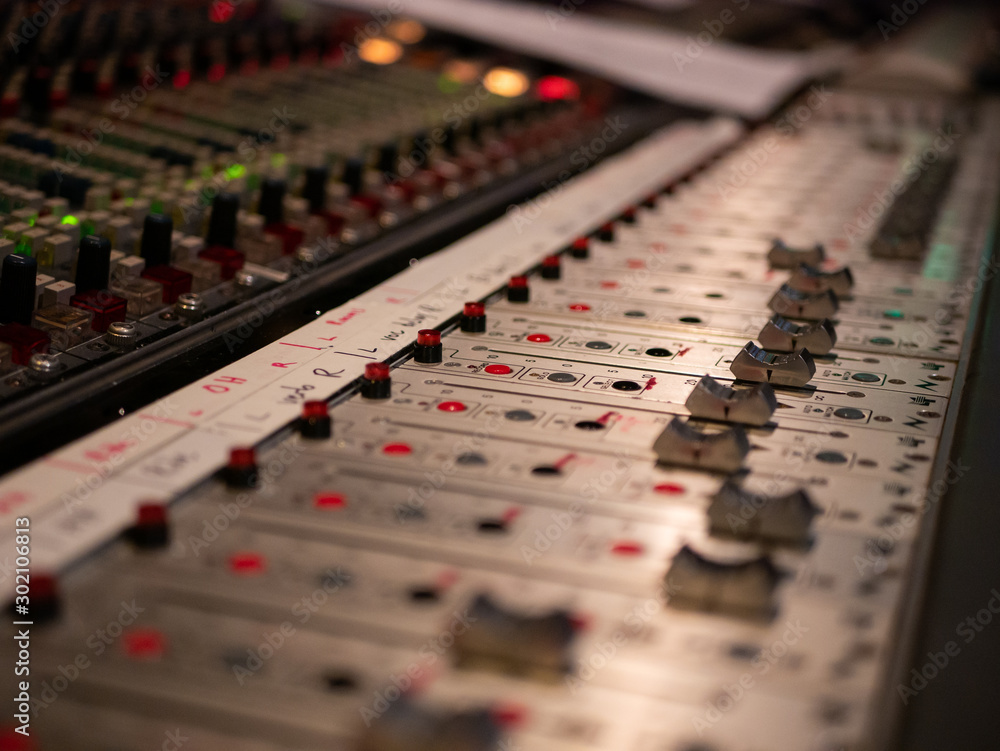 Fototapeta Audio mixing console in a studio