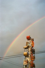 Fair Ride With Rainbow Background