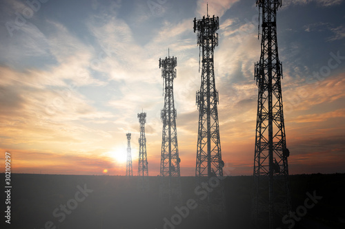 Antenna The signal tower has a sunset background. Canvas Print