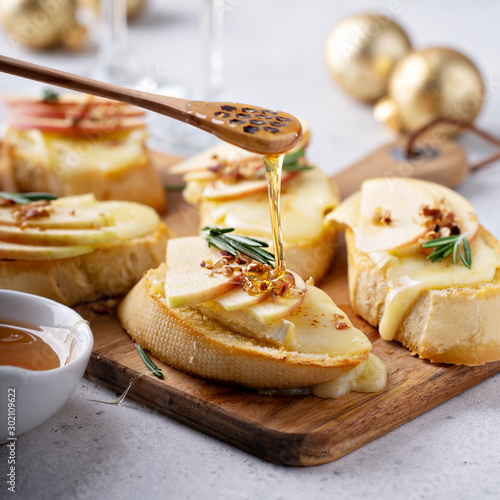 Pear and brie crostini with honey, pecan and rosemary, New Years Eve or Christma Canvas Print