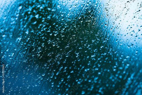 Obraz heavy rain drops on blue window - fototapety do salonu