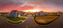 American Single Family Home Street With Stunning Red, Orange Sunset View