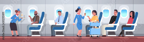 flight attendants serving mix race passengers stewardesses in uniform offering d Wallpaper Mural