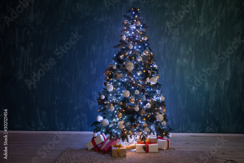Christmas tree garland lights with gifts of new year holiday winter