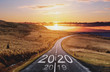 canvas print picture - 2020 and 2019 on the empty road at sunset. New Year concepts