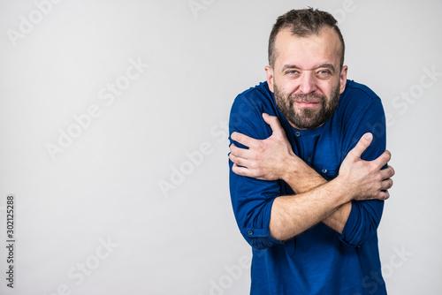 Obraz Man feeling cold gesturing - fototapety do salonu