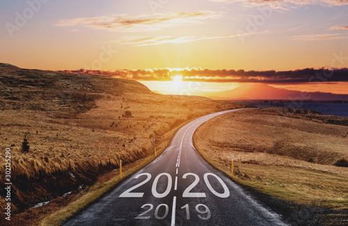 Fototapeta 2020 and 2019 on the empty road at sunset. New Year concepts obraz