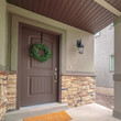 Square Front door of suburban home with American flag