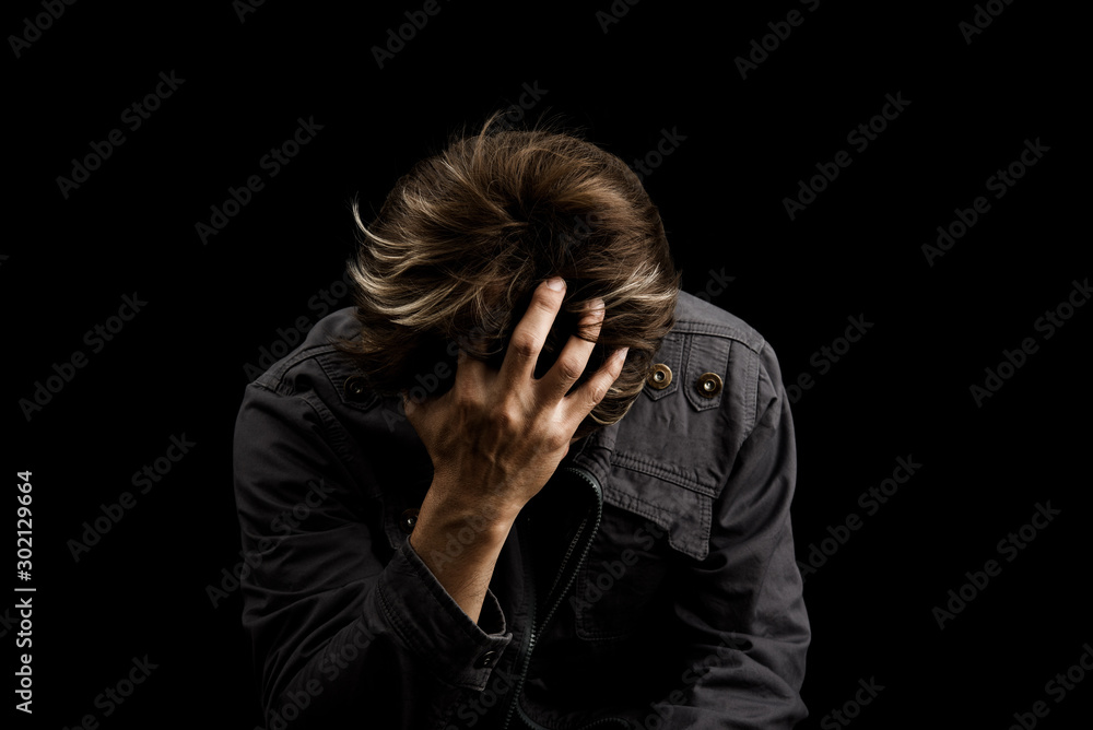 Fototapeta Man sad or cry alone in dark background asia people adult worry unhappy