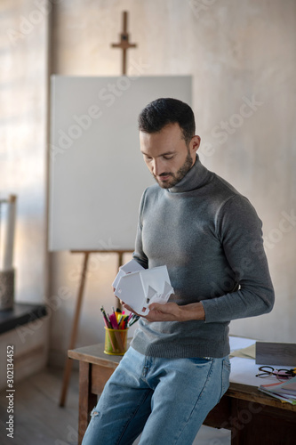Interior designer wearing jeans standing near table Fototapeta