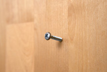 A Screw Embedded In The Surface Of Wood.