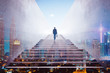 canvas print picture - Rear view of a businessman climbing stairs to get to a large city center. Concept of success and appreciation. Double exposure