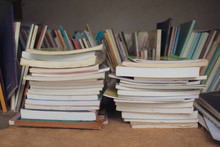 Untidy Bookshelf With A Pile Of Books