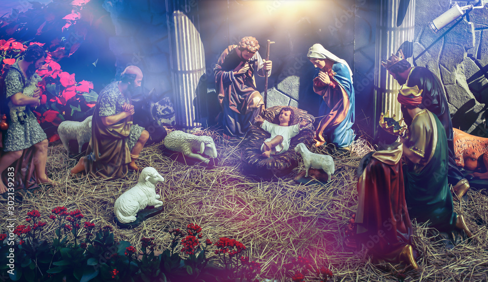 Fototapeta Traditional Christmas scenes and sacred light shining for use in illustration design Nativity scenes with Jesus baby on the manger with carvings, including Jesus, Mary, Joseph, sheep and magi