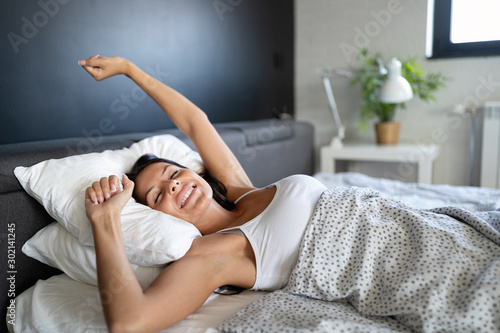 Obraz Young beautiful woman waking up fully rested - fototapety do salonu