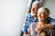 Leinwanddruck Bild - Happy senior couple in love hugging and bonding with true emotions at home