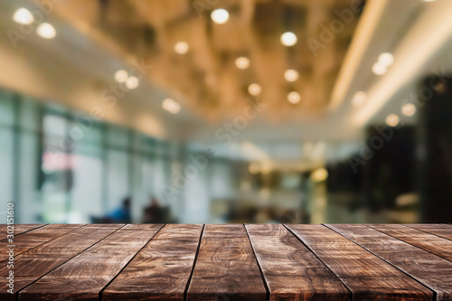 Fototapeta  Empty wood table top and blurred coffee shop and restaurent interior background - can used for display or montage your products