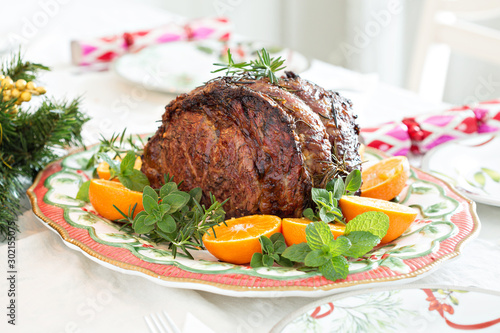 Cuadros en Lienzo Holiday Christmas prime rib beef roast on the table