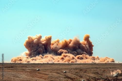 Valokuva  Dust span after detonator blast on the construction site