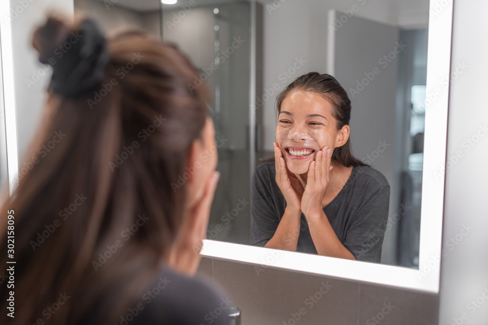 Fototapety, obrazy: Face wash young Asian woman washing using facial scrub exfoliating skin cleansing of dead cells and oil for black pores clear skincare treatment.
