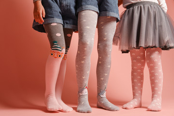 legs of girls in childrens colorful tights