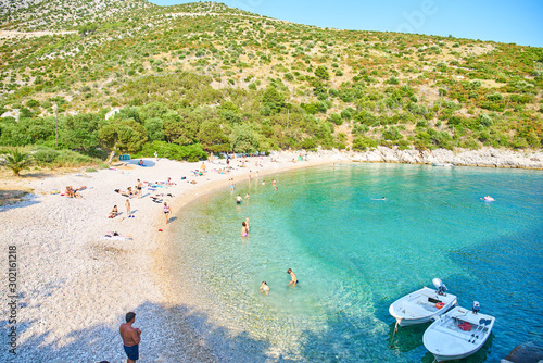 Fotografiet Beaches of Hvar, Croatia; turquoise waters, green pine trees and rocks