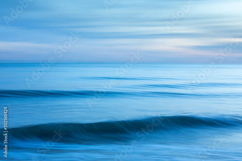 Abstract minimalist blue seascape at sunset taken at Brighton, East Sussex, UK.