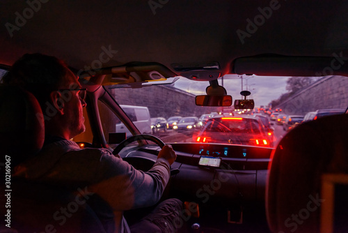 fototapeta na ścianę Driving a car in the city at night in traffic jams