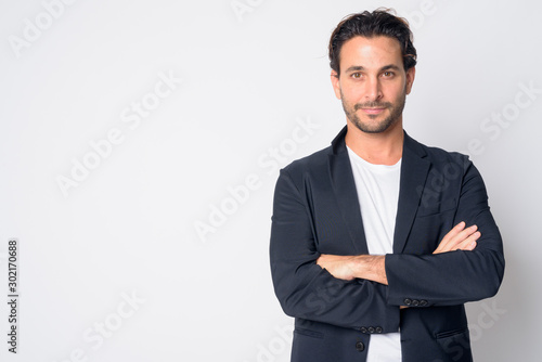 Fotografia Portrait of handsome Hispanic businessman with arms crossed