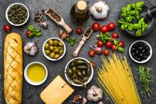 Mediterranean Diet Background Or Italian Food Ingredients On Dark Slate.