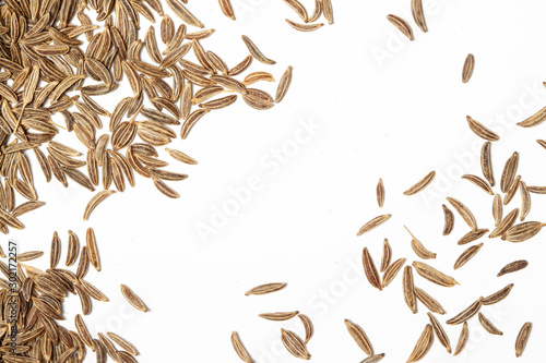 Fototapeta Caraway, cumin, cummin scattered spices with pattern for background above view obraz