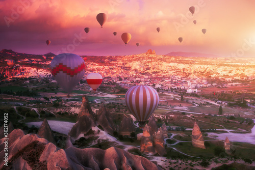 Foto auf Gartenposter Koralle Beautiful morning with flying balloons over spectacular Cappadocia, Turkey