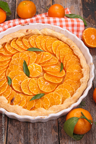 orange tart, citrus fruit cake on wood background Canvas Print