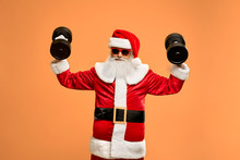 Happy Santa Claus Practicing With Two Black Dumbbells