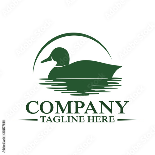 Modern floating duck and hunting logo. Vector illustration. Canvas Print
