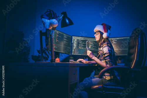 Fototapeta  Profile photo of programmer lady with sparkling wine glass watching screen worki