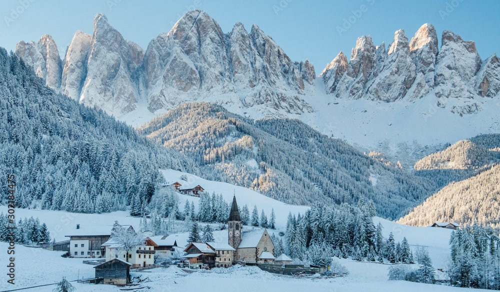 Fototapeta The small village in Dolomites mountains in winter.