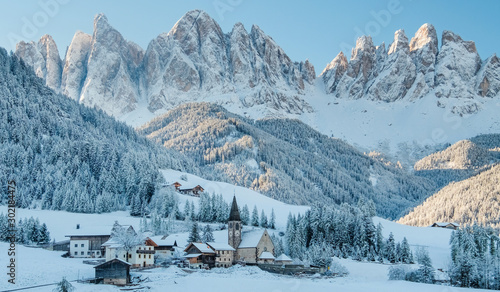 Foto auf Leinwand Himmelblau The small village in Dolomites mountains in winter.