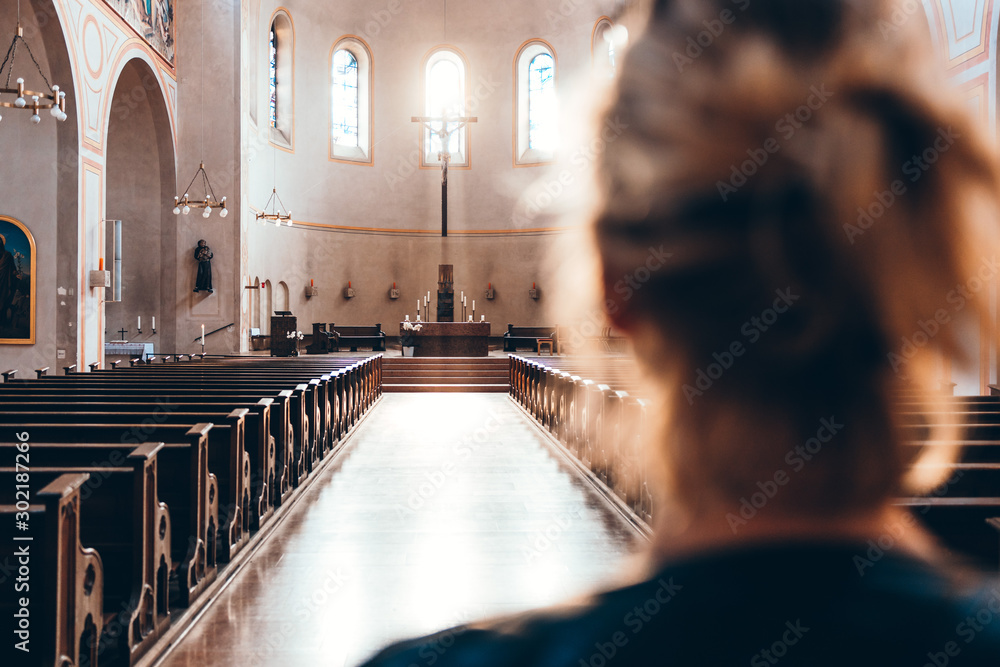 Fototapeta Woman in church heading to altar