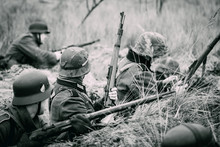 Wehrmacht Soldiers In The Trenches With Rifles On The Black White Image