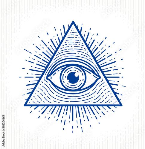Fényképezés  All seeing eye of god in sacred geometry triangle, masonry and illuminati symbol, vector logo or emblem design element