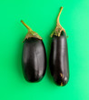 canvas print picture - Eggplant isolated on a green background
