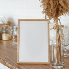 Wooden Frame On The Kitchen Table In The Interior.